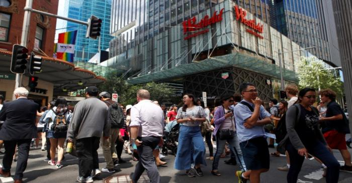 FILE PHOTO: Pedestrians walk past a Westfield shopping mall in Sydney