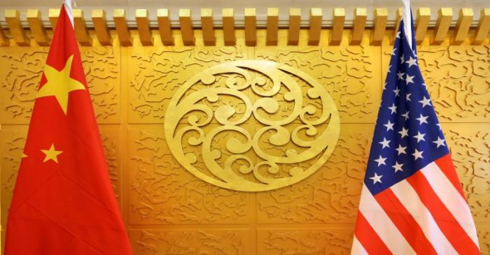 Chinese and U.S. flags are set up for a meeting during a visit by U.S. Secretary of