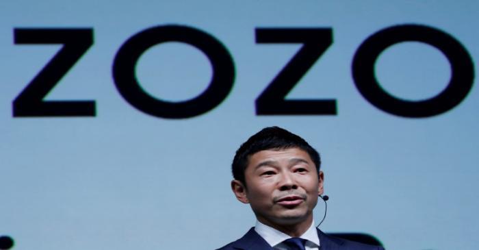 FILE PHOTO: FILE PHOTO : Japanese billionaire Yusaku Maezawa speaks at an event  in Tokyo,