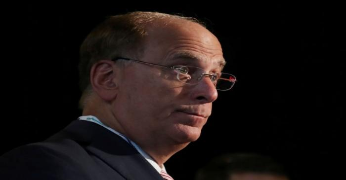 FILE PHOTO: Larry Fink, Chief Executive Officer of BlackRock, stands at the Bloomberg Global