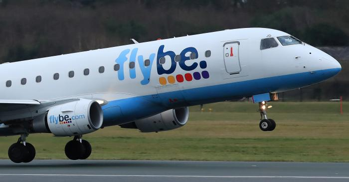 A Flybe plane takes off from Manchester Airport in Manchester, Britain
