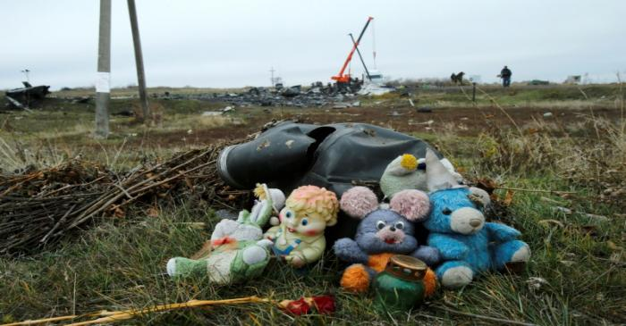 FILE PHOTO: Soft toys are seen near the crash site of the Malaysia Airlines Boeing 777 plane