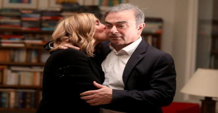 Former Nissan chairman Carlos Ghosn and his wife Carole Ghosn pose for a picture after an