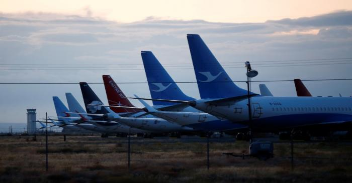 FILE PHOTO: The tails of Boeing 737 MAX aircraft are seen parked at Boeing facilities at the