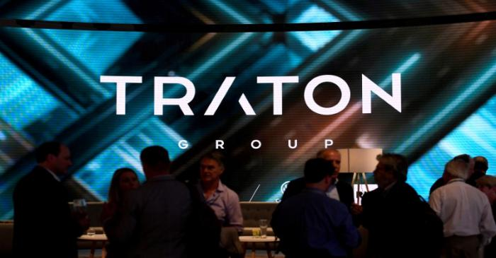 FILE PHOTO: Visitors stand at booth of VW's truck unit Traton Group in Hanover