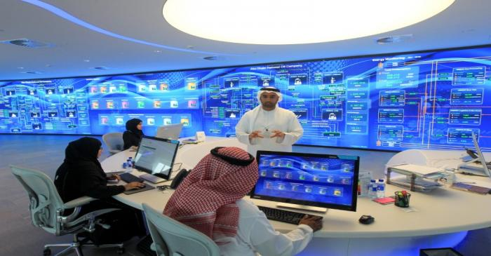 Employees are seen at the Panorama Digital Command Centre at the ADNOC headquarters in Abu