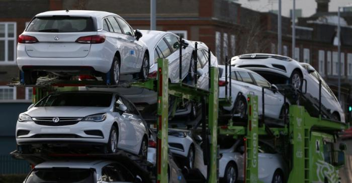 FILE PHOTO: Vauxhall cars are transported on a lorry in Luton, Britain
