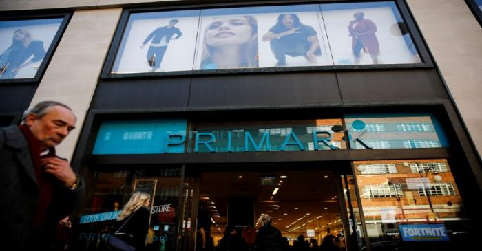 FILE PHOTO: Shoppers walk past a Primark store on Oxford Street in London