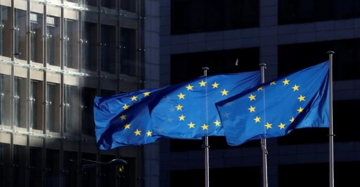 European Union flags fly outside the European Commission headquarters in Brussels