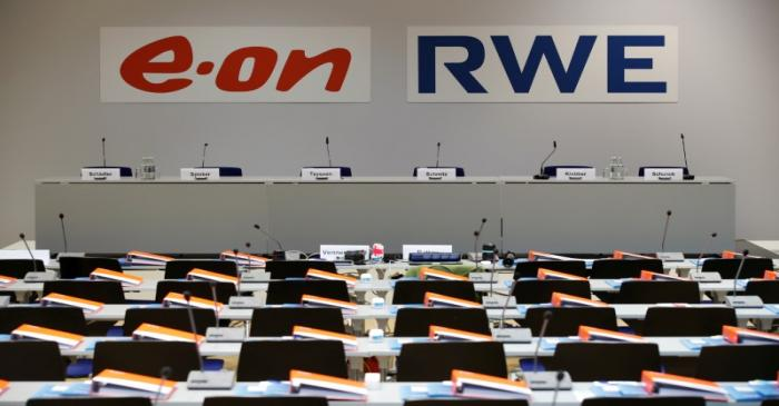 The logos of RWE and E.ON are seen before a joint news conference of the two German utilities