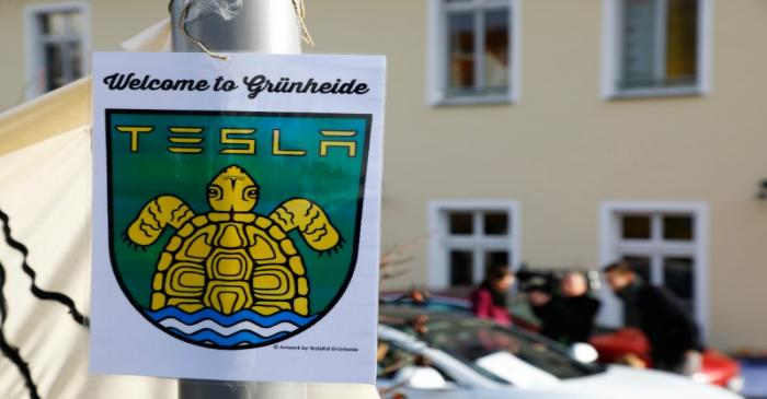 A pro-Tesla poster is seen during an action to support plans by U.S. electric vehicle pioneer