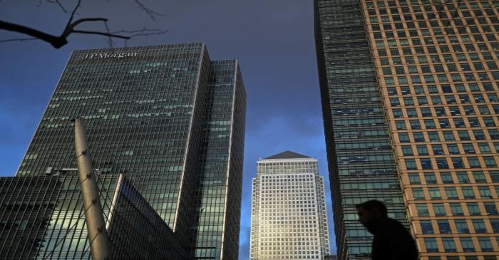 A person walks through the Canary Wharf financial district of London