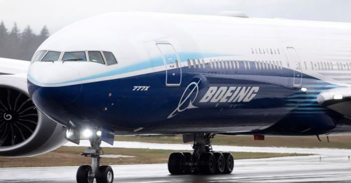 A Boeing 777X airplane taxis during an attempted first test flight from the company's plant in