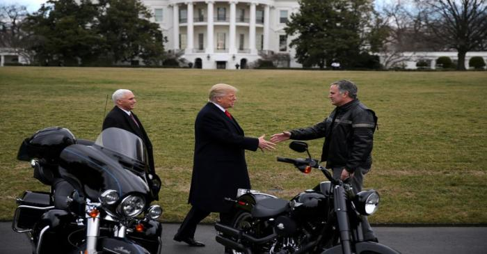 FILE PHOTO: U.S. President Donald Trump shakes hands with Matthew S Levatich, CEO of Harley