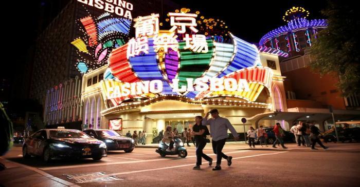 FILE PHOTO: People walk in front of Casino Lisboa in Macau