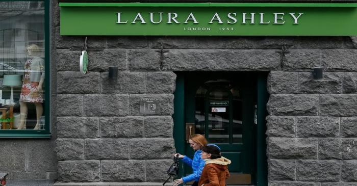 People walk past Laura Ashley store in Kiev