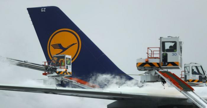 A Lufthansa passenger aircraft undergoes de-icing before takeoff from Frankfurt airport