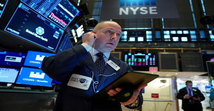 FILE PHOTO: A trader works at the New York Stock Exchange