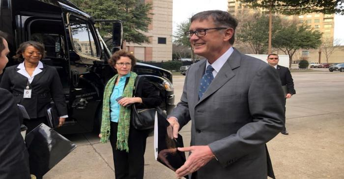 FILE PHOTO: Federal Reserve Vice Chairman Clarida boards a bus to tour South Dallas as part of
