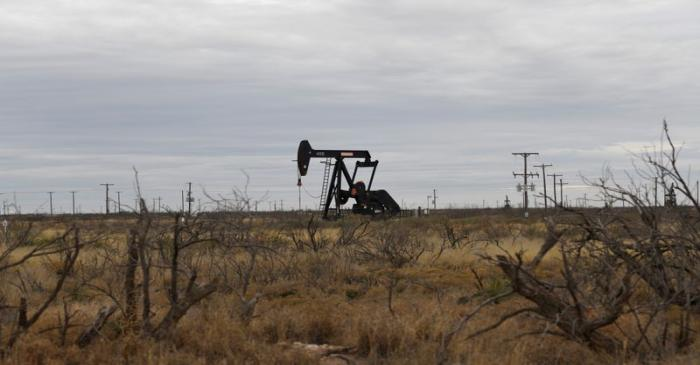 A pump jack operates in the Permian Basin oil and natural gas production area near Odessa