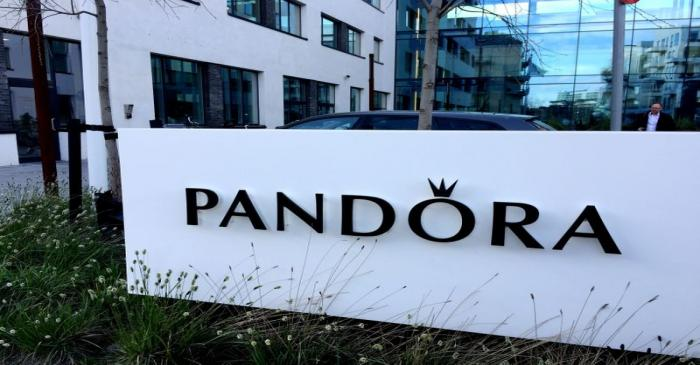 FILE PHOTO: A Pandora sign is seen at the company's headquarters in Copenhagen