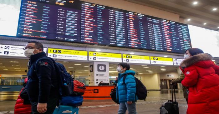 Passengers wear masks at Moscow's Sheremetyevo Airport
