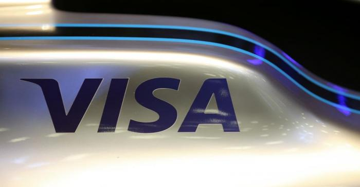 A Visa logo is seen on a Formula E racing car during a news conference to present the