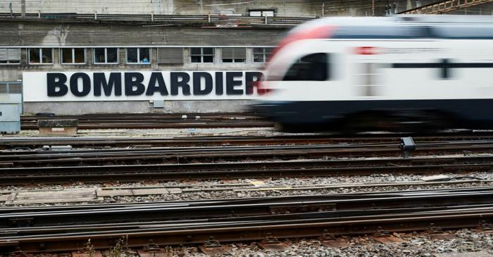 A Bombardier advertising board is pictured in front of a SBB CFF Swiss railway train at the