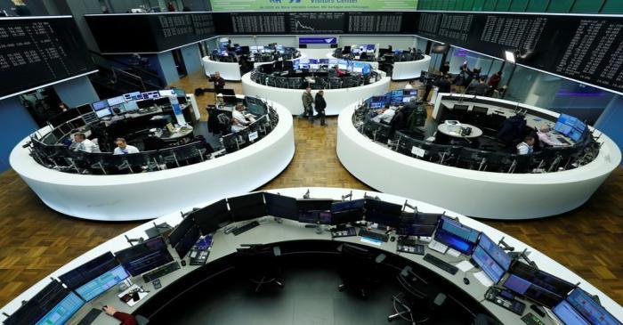 FILE PHOTO:  Traders work at Frankfurt's stock exchange in Frankfurt