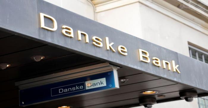 Danske bank signs are seen on a bank's headquarters in Copenhagen