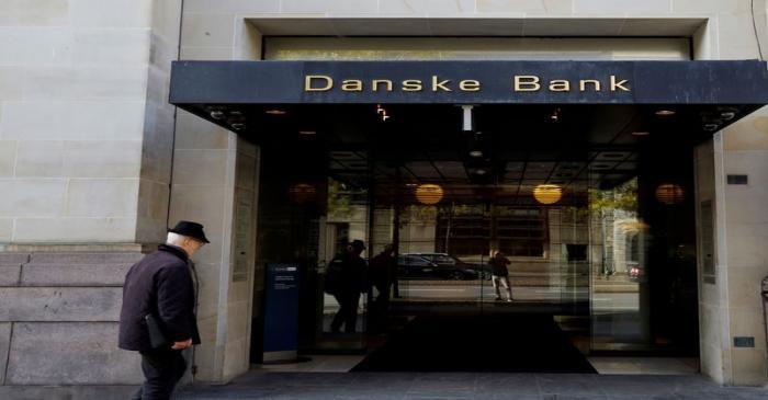 FILE PHOTO: A man walks into Danske bank headquarters in Copenhagen