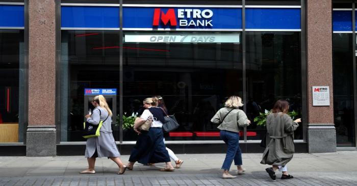 People walk past a Metro Bank in London