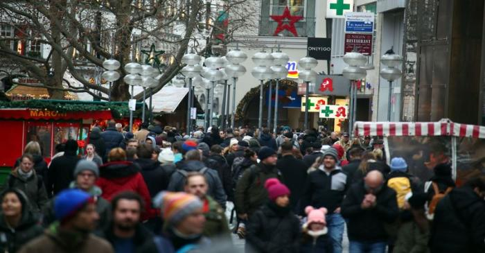 People stroll at Munich's main shopping street ahead of the Christmas celebrations in Munich