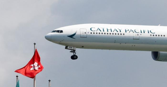 FILE PHOTO: A Cathay Pacific Boeing 777 plane lands at Hong Kong airport after it reopened
