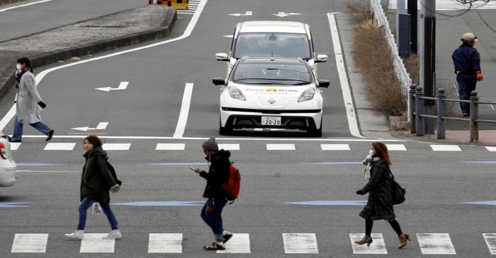 FILE PHOTO: A self-driving vehicle, based on Nissan Leaf EV, for Easy Ride service, developed