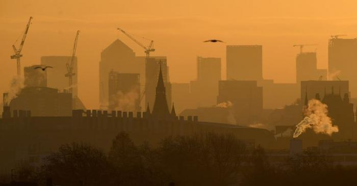 Skyscrapers and buildings are seen at dawn looking across central London towards the Canary