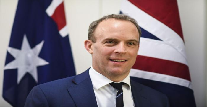 Britain's Foreign Secretary Dominic Raab poses for photographs ahead of a bilateral meeting at