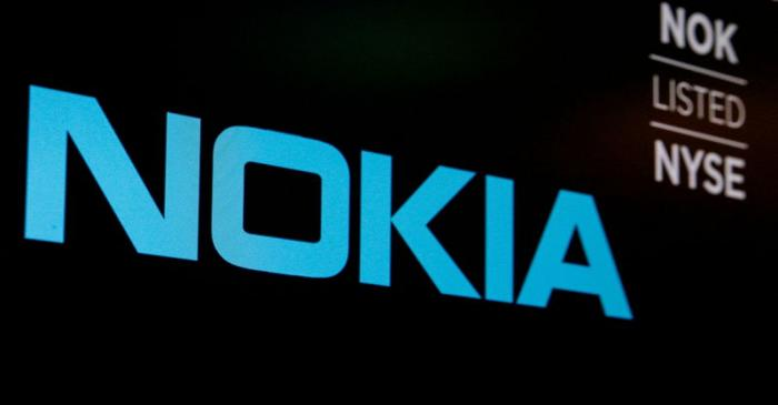 FILE PHOTO: The logo and ticker for Nokia are displayed on a screen on the floor of the NYSE in