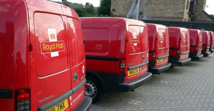 Royal Mail vans are parked in the Leytonstone post office depot in London, Britain