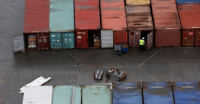 A worker opens the door of a container at DP World London Gateway container port in Essex,