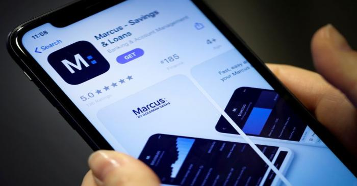 FILE PHOTO: A woman looks at Marcus, a new savings and loans app recently launched by Goldman