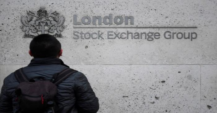 FILE PHOTO:  People walk past the London Stock Exchange Group offices in the City of London,