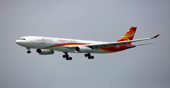 FILE PHOTO:  A Hong Kong Airlines Airbus A330-343 descends before landing at Hong Kong Airport