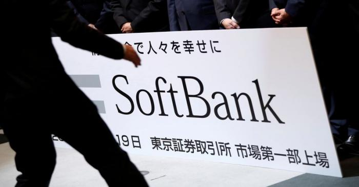 FILE PHOTO: SoftBank Corp. placard is prepared during a ceremony to mark the company's debut on
