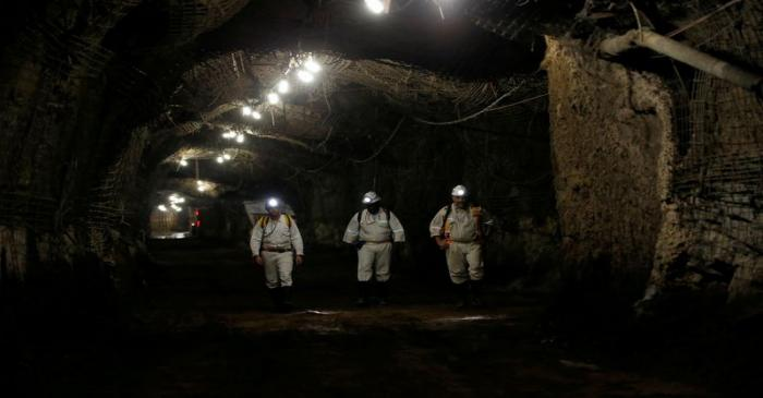 FILE PHOTO: Workers are seen underground South Africa's Gold Fields South Deep mine in
