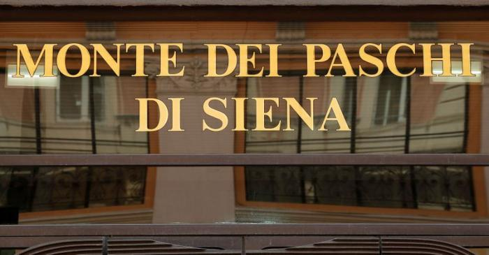 FILE PHOTO: A sign of the Monte dei Paschi bank is seen in Rome, Italy