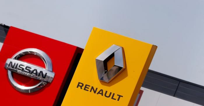 FILE PHOTO: The logos of car manufacturers Renault and Nissan are seen in front of dealerships