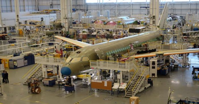An Airbus A220 passenger jet stands in the final assembly line, where the European company