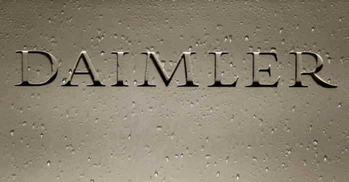 FILE PHOTO: Daimler AG sign with raindrops is pictured before the company's 2016 annual news