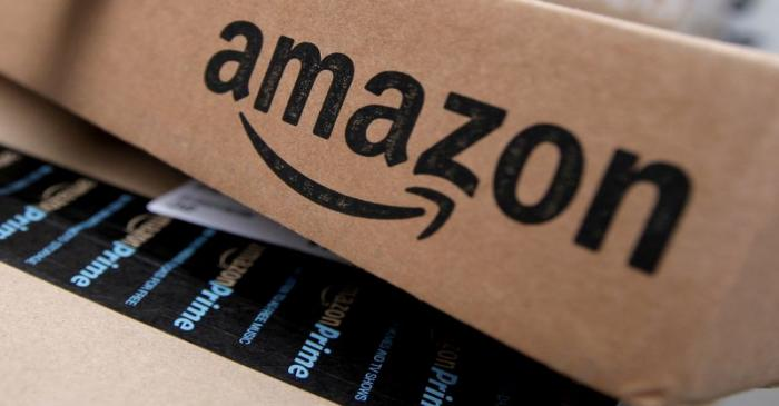 FILE PHOTO: Amazon boxes are seen stacked for delivery in the Manhattan borough of New York